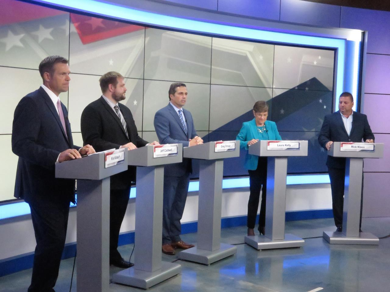 Republican Kris Kobach, from left to right, Libertarian Jeff Caldwell, independent Greg Orman, Democrat Laura Kelly and independent Rick Kloos participate in a gubernatorial debate at KWCH-TV, Tuesday, Oct. 9, 2018, in Wichita, Kan. (Dion Lefler/The Wichita Eagle via AP)