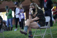 An unidentified woman cries during a ceremony Thursday, Oct. 1, 2020, on the anniversary of the mass shooting three years earlier in Las Vegas. The ceremony was held for survivors and victim's families of the deadliest mass shooting in modern U.S. history. (AP Photo/John Locher)