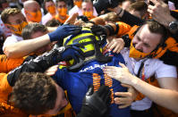 Mclaren driver Lando Norris of Britain is congratulated after taking third place in the Austrian Formula One Grand Prix at the Red Bull Ring racetrack in Spielberg, Austria, Sunday, July 4, 2021. (Christian Bruna/Pool Photo via AP)