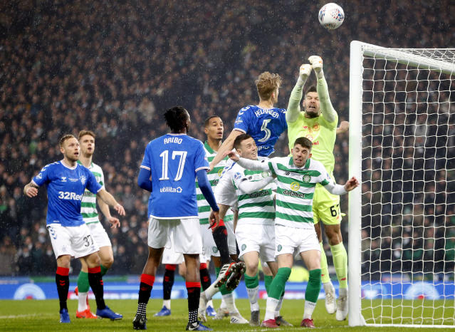 Celtic goalkeeper Fraser Forster punches the ball during the Scottish Cup Final at Hampden Park, Glasgow, Scotland, Sunday, Dec. 8, 2019. (Jeff Holmes/PA via AP)