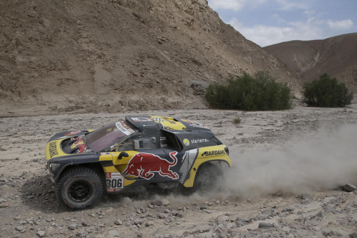 Driver Sebastien Loeb, of France, and co-driver Daniel Elena, of Monaco, race their Peugeot during stage four of the Dakar Rally between Arequipa and Moquegua, Peru, Thursday, Jan. 10, 2019. (AP Photo/Ricardo Mazalan)
