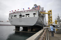 A television cameraman videotapes the USNS John Lewis before a christening ceremony Saturday July 17, 2021, in San Diego. (AP Photo/Denis Poroy)