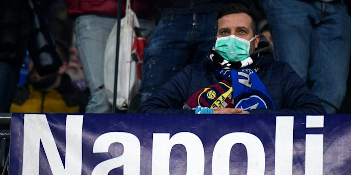 Fan wearing masks for fear of coronavirus infection (COVID-19) at the San Paolo Stadium in Naples, during the football match UEFA Champions League, SSC Napoli vs FC Barcelona on Tuesday.