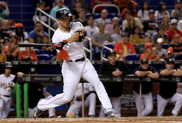 Giancarlo Stanton of the Miami Marlins hits during a game against the Atlanta Braves, at Marlins Park in Miami, Florida, on September 30, 2017 (AFP Photo/Mike Ehrmann)