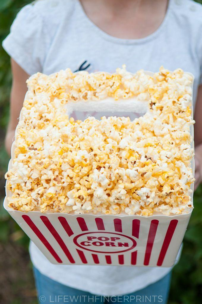 """<p>This clever Valentine's box is perfect for any age. It's actually easier to make than you might guess! </p><p><strong>Get the tutorial at </strong><a href=""""https://www.lifewithfingerprints.com/2016/02/valentines-day-box-popcorn-bucket.html/"""" rel=""""nofollow noopener"""" target=""""_blank"""" data-ylk=""""slk:Life with Fingerprints."""" class=""""link rapid-noclick-resp""""><strong>Life with Fingerprints.</strong></a></p><p><a class=""""link rapid-noclick-resp"""" href=""""https://www.amazon.com/Novelty-Place-Plastic-Striped-Containers/dp/B019ET3AIG/?tag=syn-yahoo-20&ascsubtag=%5Bartid%7C2164.g.35119968%5Bsrc%7Cyahoo-us"""" rel=""""nofollow noopener"""" target=""""_blank"""" data-ylk=""""slk:SHOP POPCORN BUCKETS"""">SHOP POPCORN BUCKETS</a> </p>"""