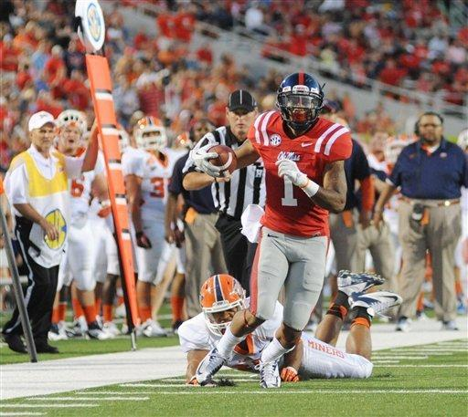 Mississippi' Randall Mackey (1) is chased by UTEP's' Felix Neboh during an NCAA college football game at Vaught-Hemingway Stadium in Oxford, Miss., Saturday, Sept. 8, 2012. (AP Photo/Oxford Eagle, Bruce Newman) MAGAZINES OUT; NO SALES; MANDATORY CREDIT