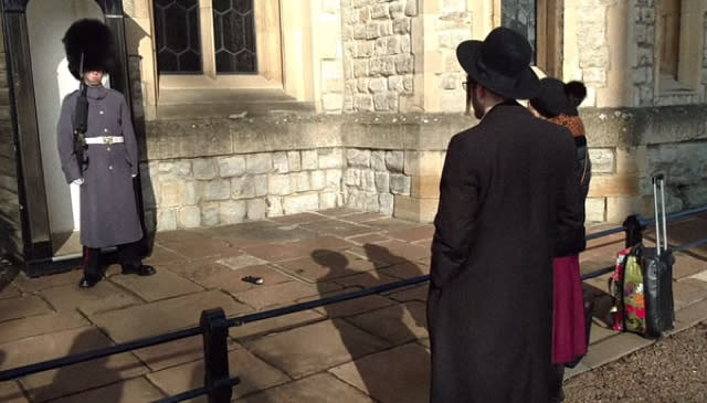 Tourists blasted for throwing glove at Queen's Guard