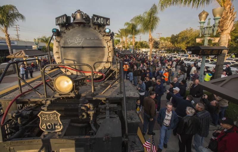 Spectators view the historic locomotive, Union Pacific Big Boy No. 4014 at Metrolink Station, Sunday, Jan. 26, 2014, in Covina, Calif. The 600-ton Big Boy locomotive left the Pomona fairgrounds on its way to a Union Pacific rail yard in Colton, about 60 miles away, where it will be available for two weekends of public viewing before moving on to Cheyenne, Wyo., for restoration work. The goal is to eventually get Engine 4014 back on the rails, said Union Pacific spokesman Aaron Hunt. (AP Photo/Ringo H.W. Chiu)