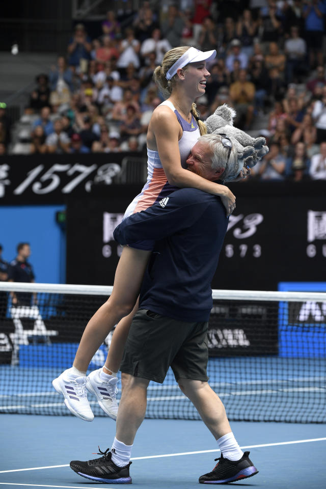 Denmark's Caroline Wozniacki is carried by her coach and father Piotr after her third round loss to Tunisia's Ons Jabeur at the Australian Open tennis championship in Melbourne, Australia, Friday, Jan. 24, 2020. (AP Photo/Andy Brownbill)