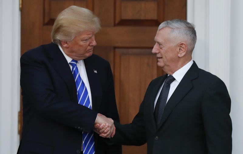 President-elect Donald Trump shakes hands with retired Marine Corps Gen. James Mattis as he leaves Trump National Golf Club in Bedminster, N.J., Nov. 19, 2016. (AP Photo/Carolyn Kaster)