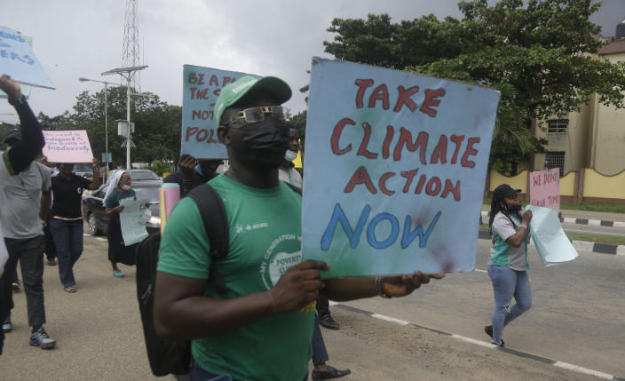 Activists march on the streets of Lagos, Nigeria, Friday Sept. 24, 2021, demanding action on climate change. Protesters around the world joined rallies on Friday as a day of worldwide demonstrations calling for action against climate change. (AP Photo/Sunday Alamba)
