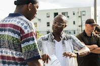 <p>Lead actor, Mahershala Ali, and director, Barry Jenkins, talk about a scene during the filming of Moonlight in Miami, Florida. </p>