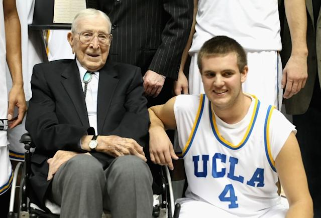 """Legendary UCLA coach John Wooden poses with great-grandson Tyler Trapani following a game in 2008. <span class=""""copyright"""">(Mark J. Terrill / Associated Press)</span>"""