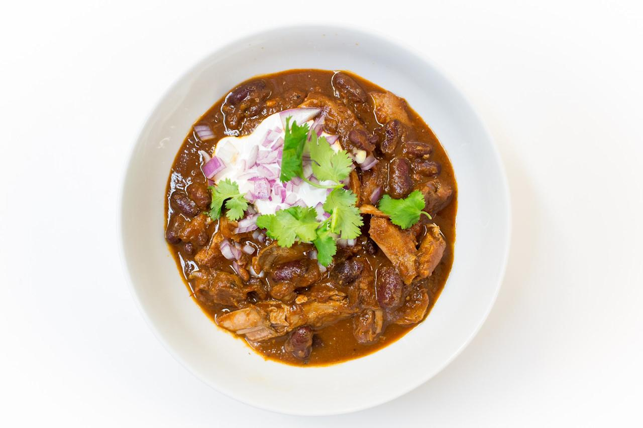 """Use already cooked turkey drumsticks for this chili recipe to significantly cut down on prep time. <a href=""""https://www.bonappetit.com/recipe/dark-meat-turkey-chili?mbid=synd_yahoo_rss"""">See recipe.</a>"""