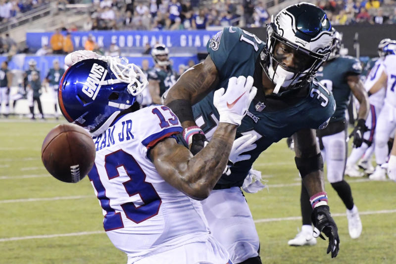 Philadelphia Eagles' Jalen Mills (31) defends against New York Giants' Odell Beckham (13) during the second half of an NFL football game Thursday, Oct. 11, 2018, in East Rutherford, N.J. The Eagles won 34-13. (AP Photo/Bill Kostroun)