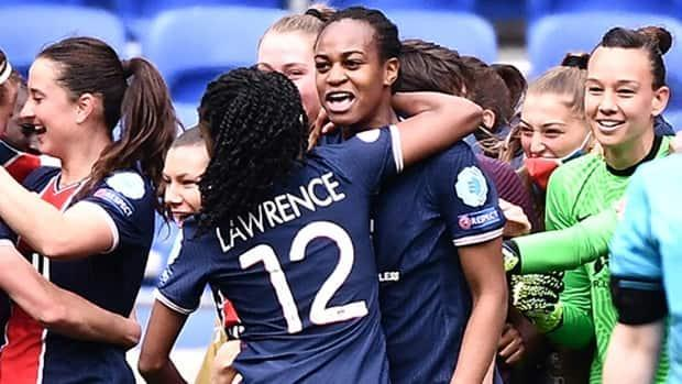 Toronto's Ashley Lawrence celebrates with a teammate after Paris Saint-Germain upset five-time defending champion Lyon 2-1 in UEFA Women's Champions League quarter-final play on Sunday. (Jeff Pachoud/AFP via Getty Images - image credit)