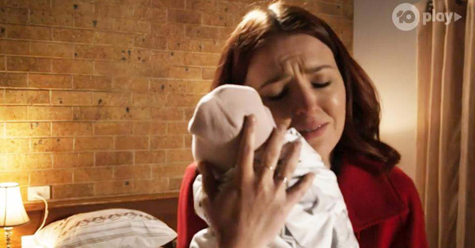 Neighbours actor Charlotte Chimes in character as Nicolette Stone with her baby Isla