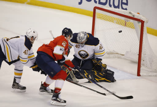 Florida Panthers center Aleksander Barkov (16) scores against Buffalo Sabres goaltender Robin Lehner (40) and defenseman Justin Falk (41) during the second period of an NHL hockey game, Friday, March 2, 2018, in Sunrise, Fla. (AP Photo/Wilfredo Lee)