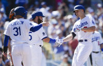 Los Angeles Dodgers' Corey Seager, right, celebrates with Joc Pederson, left, and Russell Martin after a three-run home run during the fifth inning of a baseball game against the San Francisco Giants in Los Angeles, Sunday, Sept. 8, 2019. (AP Photo/Kelvin Kuo)