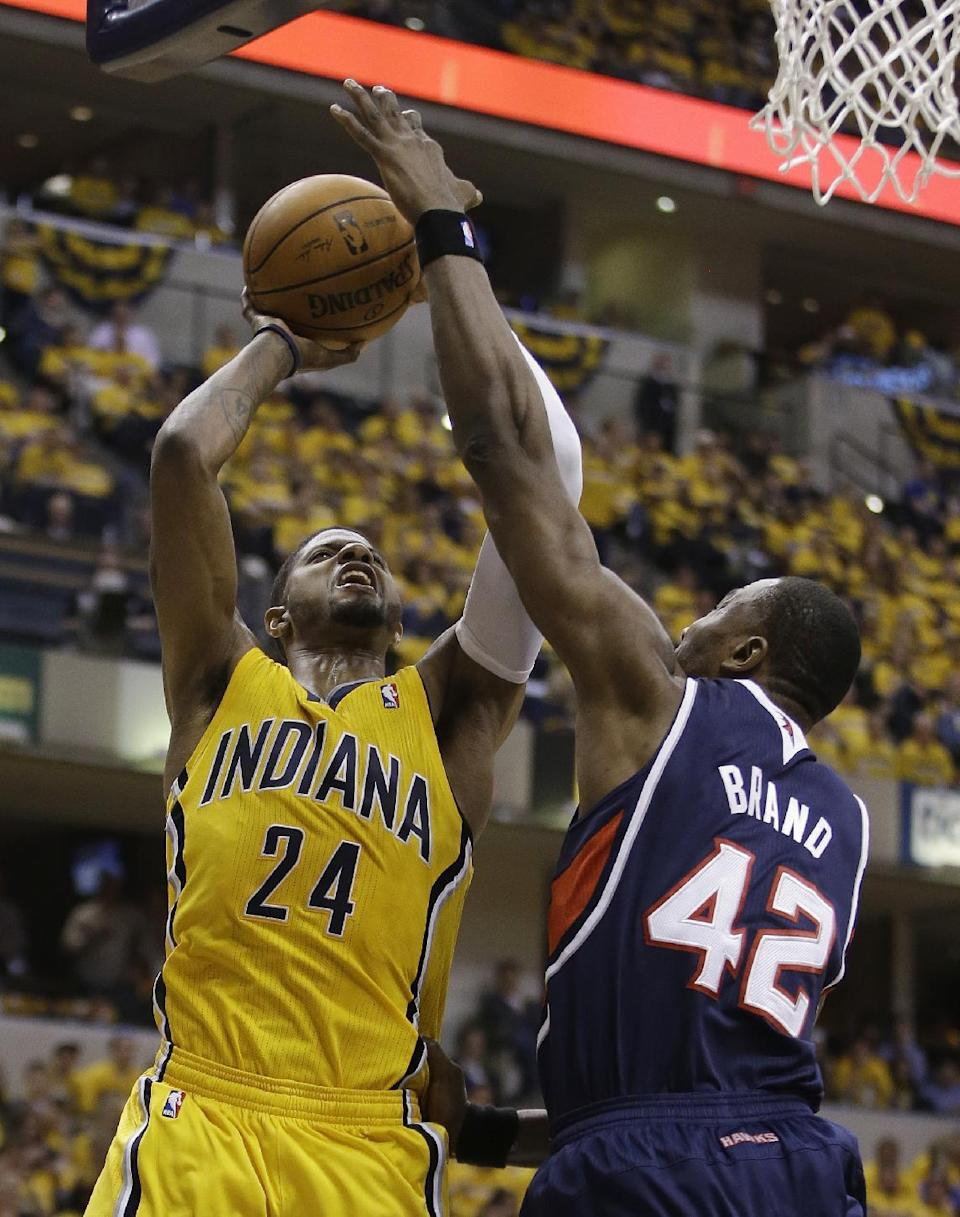 Indiana Pacers' Paul George (24) shootsagainst Atlanta Hawks' Elton Brand during the second half in Game 1 of an opening-round NBA basketball playoff series on Saturday, April 19, 2014, in Indianapolis. Atlanta defeated Indiana 101-93. (AP Photo/Darron Cummings)