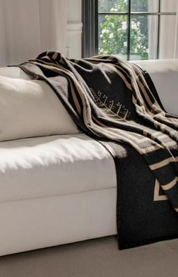 Leather Trim Throw woven from 100% Italian cashmere featuring a contemporary modern design