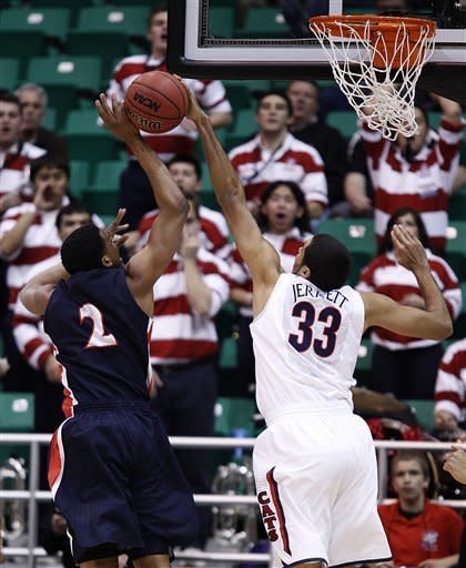 Belmont's Blake Jenkins (2) has his shot blocked by Arizona's Grant Jerrett during the first half of a second-round game in the NCAA college basketball tournament in Salt Lake City Thursday, March 21, 2013. (AP Photo/George Frey)