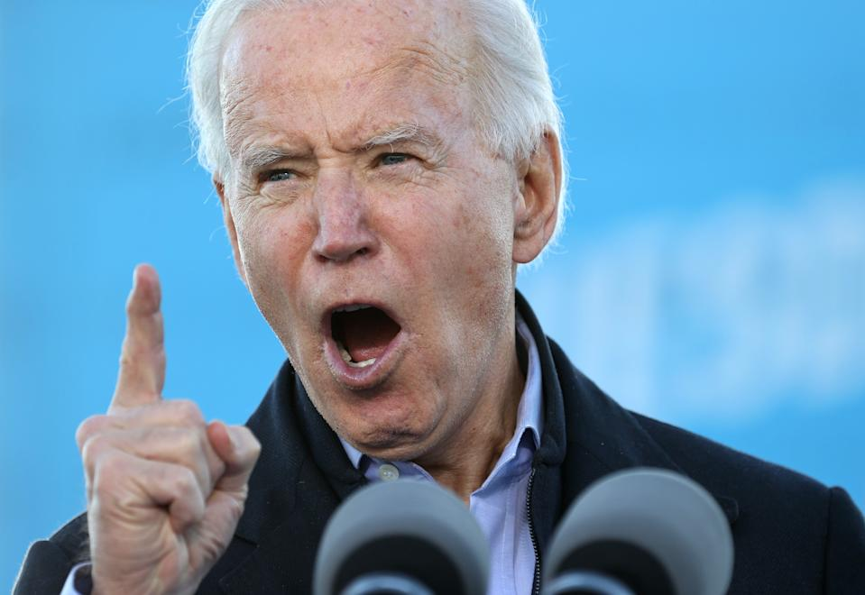 """ATLANTA, GEORGIA - JANUARY 04: President-elect Joe Biden speaks during a campaign rally with Democratic candidates for the U.S. Senate Jon Ossoff and Rev. Raphael Warnock the day before their runoff election in the parking lot of Centerparc Stadium January 04, 2021 in Atlanta, Georgia. Biden's trip comes a day after the release of a recording of an hourlong call where President Donald Trump implores Georgia Secretary of State Brad Raffensperger to """"find"""" the votes he would need to reverse the presidential election outcome in the state. (Photo by Chip Somodevilla/Getty Images)"""