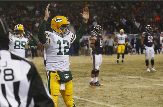 Green Bay Packers quarterback Aaron Rodgers (12) reacts after Packers' wide receiver Jarrett Boykin picked up Rodgers' fumble and ran into the end zone for a touchdown during the first half of an NFL football game against the Chicago Bears, Sunday, Dec. 29, 2013, in Chicago. (AP Photo/Charles Rex Arbogast)