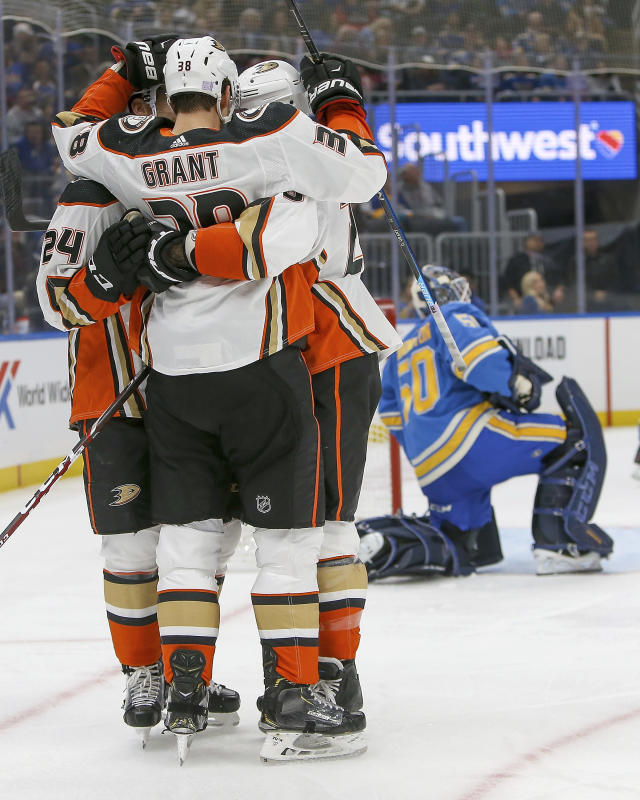 Anaheim Ducks' Derek Grant (38) is congratulated by teammates after scoring a goal during the first period of the team's NHL hockey game against the St. Louis Blues on Saturday, Nov. 16, 2019, in St. Louis. (AP Photo/Scott Kane)