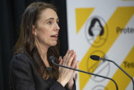 New Zealand Prime Minister Jacinda Ardern gestures during her COVID-19 response and vaccine update in Wellington, New Zealand, Thursday, Aug. 26, 2021. By early next week, New Zealanders should know if their government's strict new lockdown is working to stamp out its first coronavirus outbreak in six months. A successful effort could again make the nation's virus response the envy of the world. (Mark Mitchell/Pool Photo via AP)