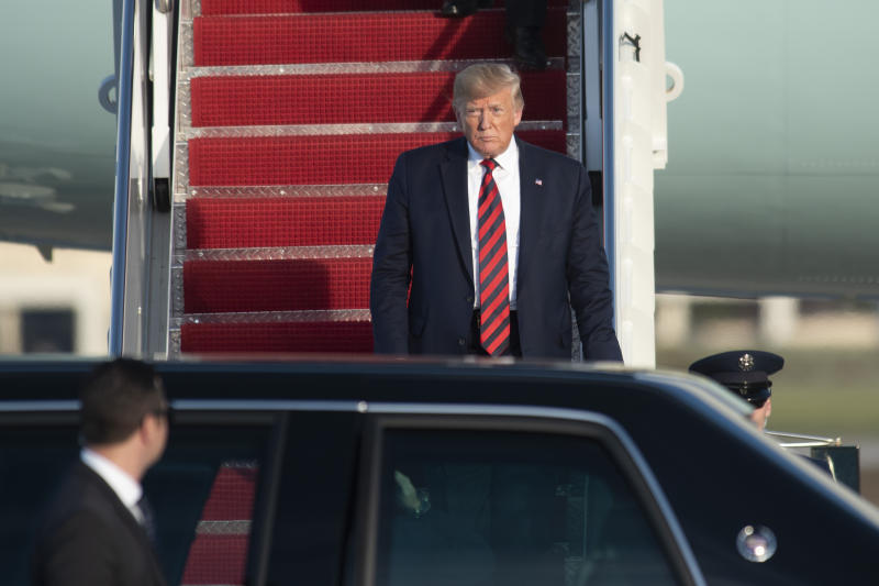 President Donald Trump walks from Air Force One at Andrews Air Force Base, Md., as he arrives following a trip to Chicago to attend the International Association of Chiefs of Police Annual Conference and Exposition, Monday, Oct. 28, 2019. (AP Photo/Kevin Wolf)