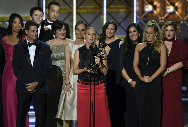 "Audrey Morrissey and crew members accept the award for Outstanding Reality Competition Program for ""The Voice"" onstage during the 69th Emmy Awards at the Microsoft Theatre on Sept. 17, 2017 in Los Angeles, California."