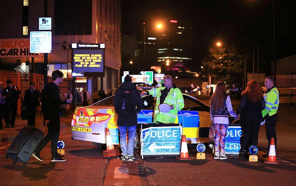 <p>Emergency services work at Manchester Arena after reports of an explosion at the venue during an Ariana Grande gig in Manchester, England Monday, May 22, 2017. Several people have died following reports of an explosion Monday night at an Ariana Grande concert in northern England, police said. A representative said the singer was not injured. (Peter Byrne/PA via AP) </p>