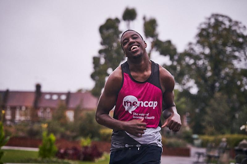 """Aaron Plummer, 20, who has cerebral palsy and a learning disability, completed the race in Walthamstow, London, to raise money for Charity of the Year, Mencap, and """"give back to the greatest charity ever"""" (Mencap/PA Wire)."""