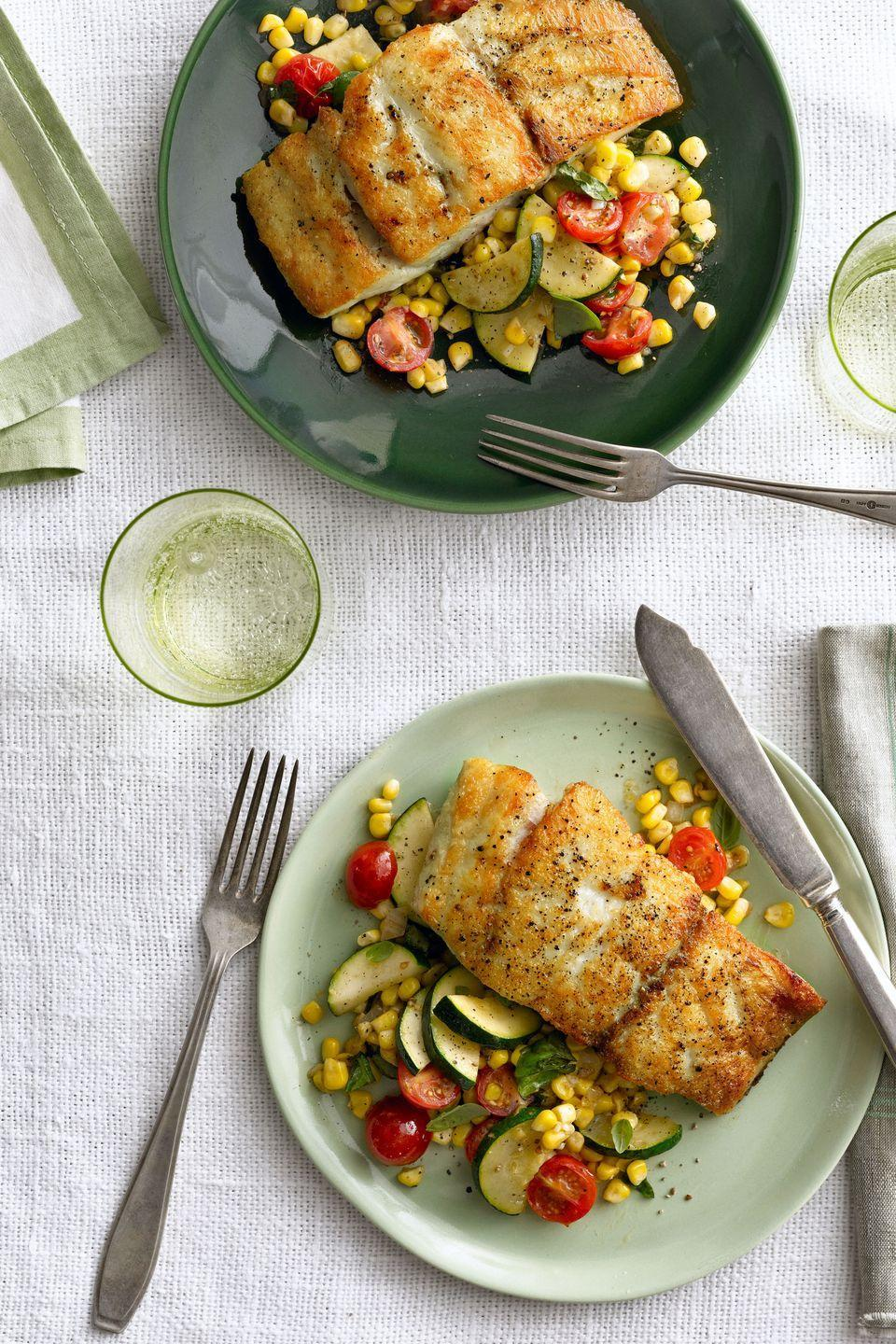 """<p>This light and refreshing dinner gets some color from a vegetable sauté.</p><p><strong><a href=""""https://www.countryliving.com/food-drinks/recipes/a5629/seared-grouper-corn-zucchini-tomato-saute-recipe-clx0914/"""" rel=""""nofollow noopener"""" target=""""_blank"""" data-ylk=""""slk:Get the recipe"""" class=""""link rapid-noclick-resp"""">Get the recipe</a>.</strong></p>"""