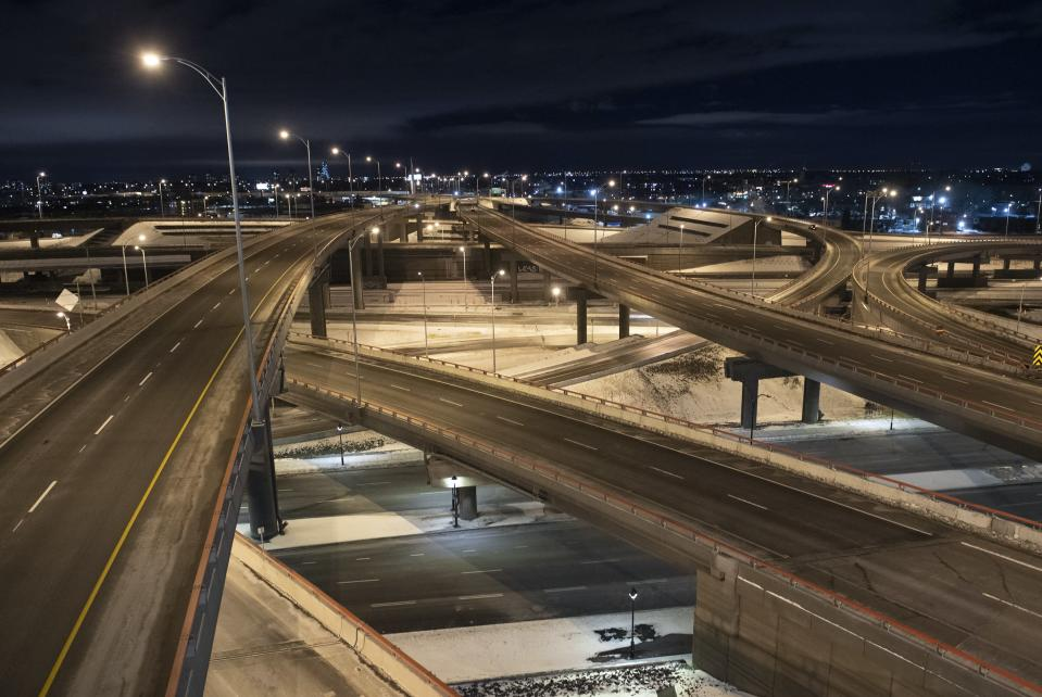 """<span class=""""caption""""> An empty Turcot Interchange is shown in Montreal, Saturday, January 9, 2021, as the COVID-19 pandemic continues in Canada and around the world. The Quebec government has imposed a curfew to help stop the spread of COVID-19 starting at 8 p.m until 5 a.m and lasting until February 8.THE CANADIAN PRESS/Graham Hughes</span> <span class=""""attribution""""><span class=""""source"""">La Presse Canadienne/Graham Hughes</span></span>"""