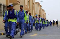 Qatar is expected to introduce a number of measures to improve labour conditions following criticism by rights campaigners about the treatment of migrant workers (AFP Photo/Marwan Naamani)