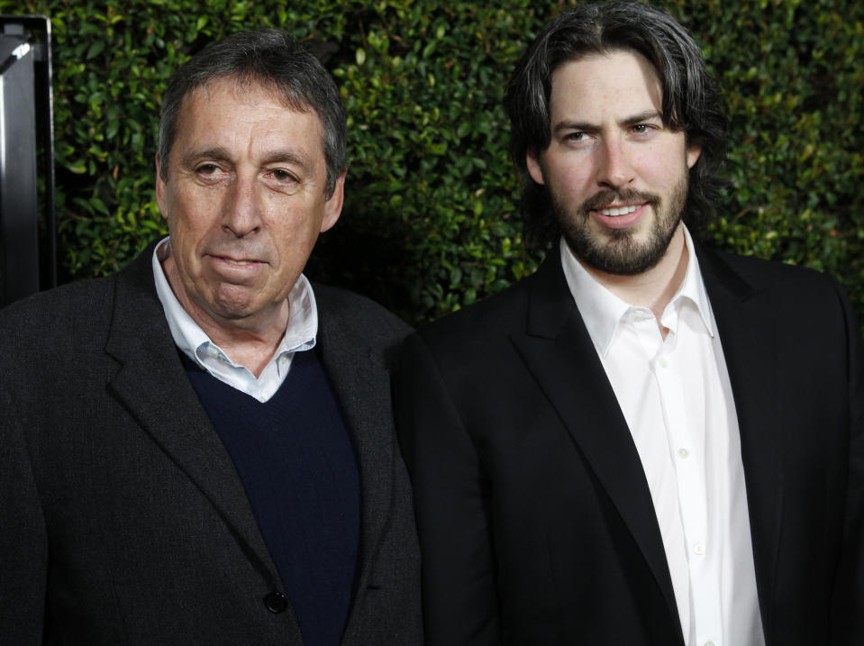 """Director Jason Reitman poses at the premiere of his film """"Young Adult"""" with his father, director Ivan Reitman, in Beverly Hills, California December 15, 2011. REUTERS/Fred Prouser (UNITED STATES - Tags: ENTERTAINMENT)"""