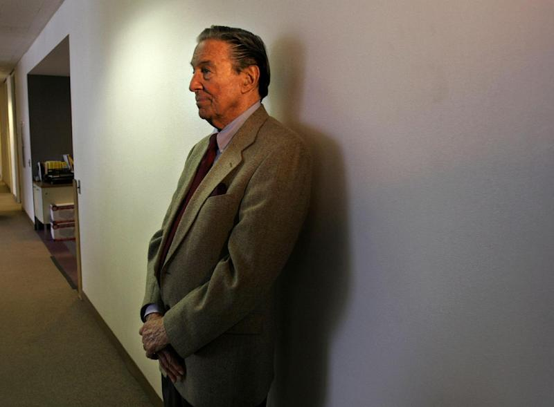 "This May 8, 2006 file photo shows Mike Wallace, veteran CBS "" 60 Minutes"" correspondent, waiting in a hallway near his office to see a colleague in New York, Monday May 8, 2006. Wallace, famed for his tough interviews on ""60 Minutes,"" has died, Saturday, April 7, 2012. He was 93. (AP Photo/Bebeto Matthews)"