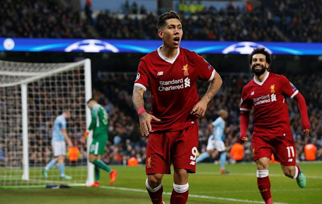 Roberto Firmino celebrates his goal that all but sealed Liverpool's aggregate victory over Manchester City in the Champions League. (Getty)