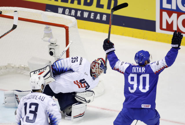 Slovakia's Tomas Tatar, right, celebrates scoring his sides third goal past goaltender Cory Schneider of the US, center, during the Ice Hockey World Championships group A match between Slovakia and the United States at the Steel Arena in Kosice, Slovakia, Friday, May 10, 2019. (AP Photo/Petr David Josek)