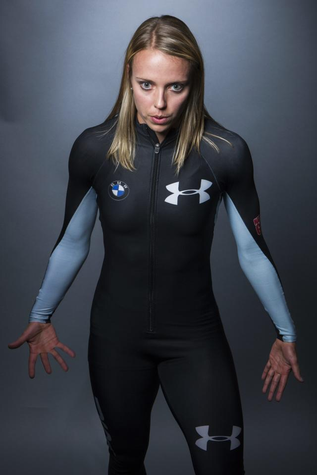 Olympic bobsledder Katie Eberling mimics the preparations she carries out before a run during the 2013 U.S. Olympic Team Media Summit in Park City, Utah