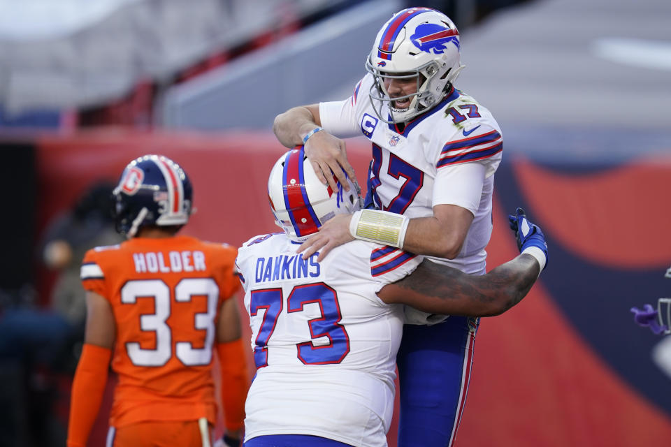Buffalo Bills quarterback Josh Allen, above, celebrates with teammate offensive tackle Dion Dawkins after scoring a touchdown. (AP Photo/David Zalubowski)