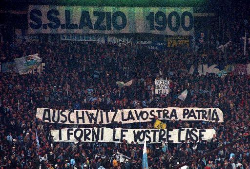"""Lazio fans have a long history of anti-Semitism. During a 1998 game against Roma, they displayed this banner that read """"Auschwitz is your homeland. The ovens are your homes."""" (AP Photo)"""