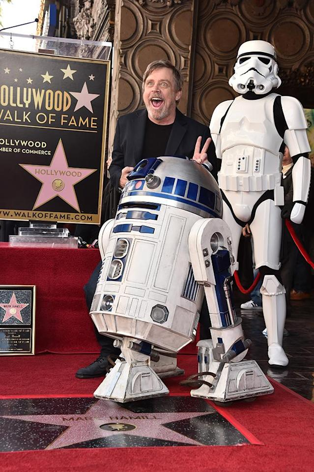 <p>The <em>Star Wars</em> icon was (naturally!) flanked by R2D2 and a storm trooper while being honored with a star on the Hollywood Walk of Fame on Thursday in Hollywood. (Photo: Alberto E. Rodriguez/Getty Images for Disney) </p>