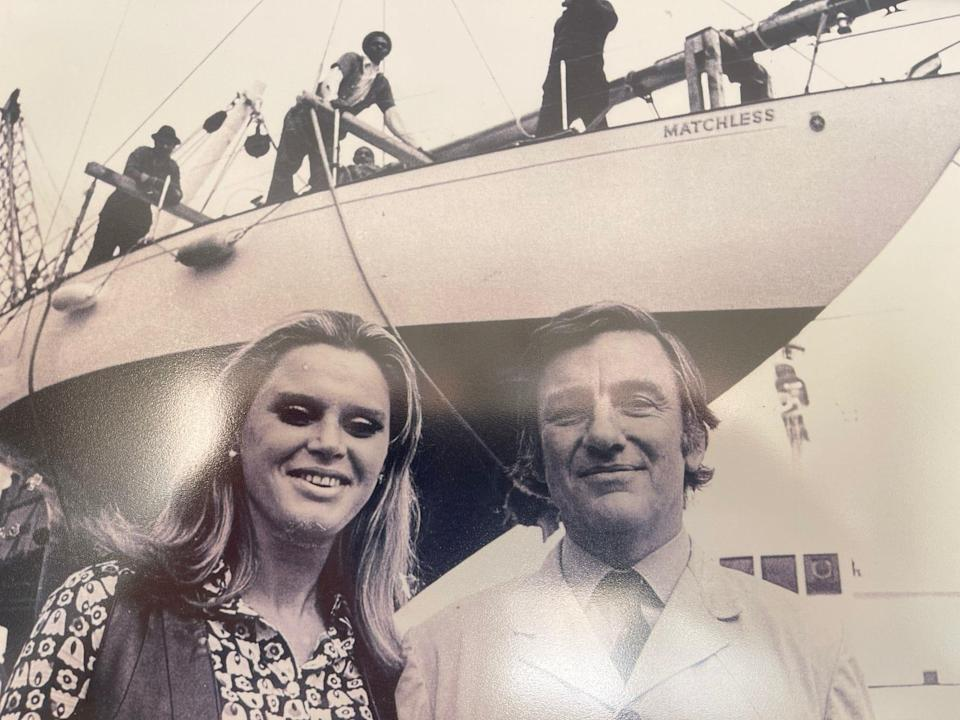 Poland and his second wife, Lorette, in front of his yacht Matchless