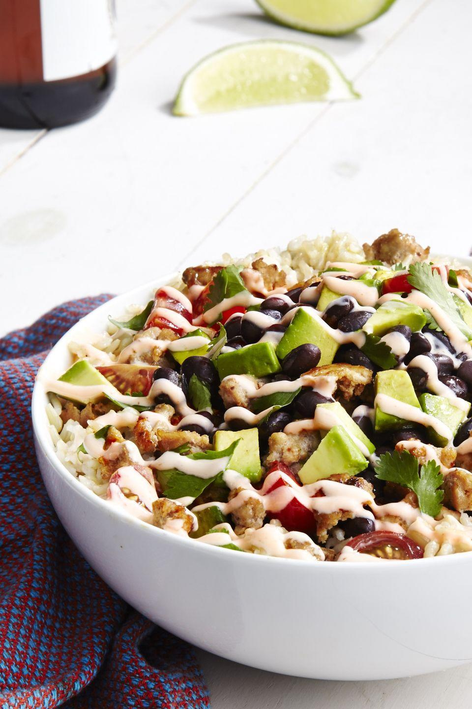 """<p>All the flavors of a burrito without all the calories.</p><p>Get the recipe from <a href=""""https://www.delish.com/cooking/recipe-ideas/recipes/a46525/skinny-burrito-bowl-recipe/?visibilityoverride"""" rel=""""nofollow noopener"""" target=""""_blank"""" data-ylk=""""slk:Delish"""" class=""""link rapid-noclick-resp"""">Delish</a>.</p>"""