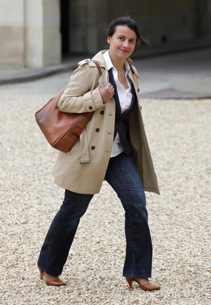 FILE - In this May 17, 2012 file photo newly named Housing Minister Cecile Duflot, wearing denim trousers, arrives for the first weekly cabinet meeting with new President Francois Hollande, at the Elysee Palace in Paris. The hooting and catcalls on Duflot began as soon as she stood, wearing a blue and white flowered dress. It did not cease for the entire time she spoke before France's National Assembly. And it came not from an unruly crowd, but from male legislators who later said they were merely showing their appreciation on a warm summer's day. French lawmakers are nearing passage of a law on sexual harassment, more than two months after the country's previous one was thrown out by a court, and all pending cases along with it. (AP Photo/Thibault Camus, File)