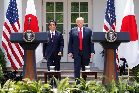 FILE PHOTO: U.S. President Trump holds joint news conference with Japan's Prime Minister Abe at the White House in Washington