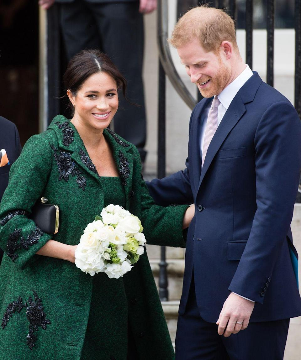 <p>Harry helps Meghan down the steps at Canada House after attending a Commonwealth Day Youth Event in London.</p>